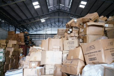Blurry image of poorly organized warehouse with a lot of messy stocks and boxes stock vector