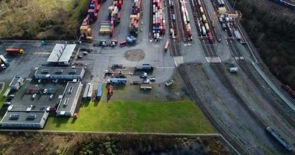 station with freight trains and containers in aerial view