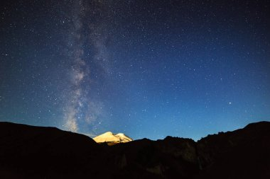 Stars and clouds over Mount Elbrus. Night landscape. Russia