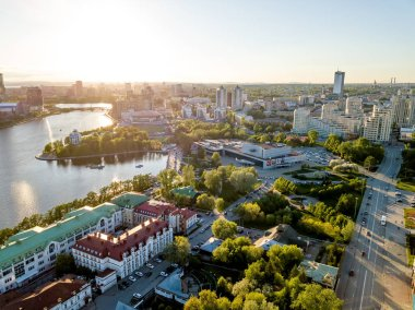 The central pond of the city. Cinema-concert theater Cosmos. Sunset. Aerial view (drone). Yekaterinburg, Russia