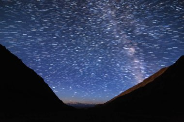 Traces of stars in the form of lines. View in the mountains. Kyrgyzstan