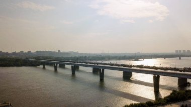 Metro Bridge and Communal Bridge. Panorama of the city of Novosibirsk. View on the river Ob. Russia, From Dron
