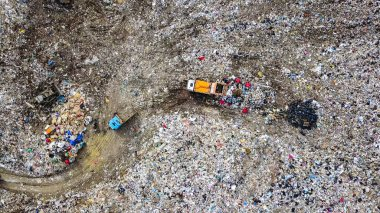 Garbage trucks unload garbage to a landfill in the vicinity of the city of Yekaterinburg, Russia, From Drone, HEAD OVER SHOT