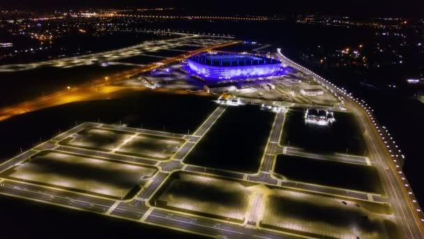 RUSSIA, KALININGRAD - SEPTEMBER 20TH, 2018: Aerial night view stadium at Kaliningrad. Football stadium in Kaliningrad, built in 2018 for the matches of 2018 FIFA World Cup. Video. UltraHD (4K)