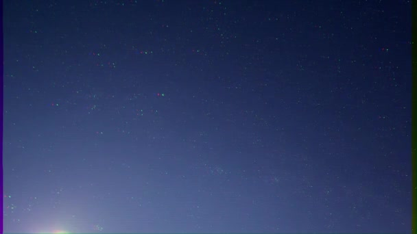Glitch effect. Starry sky with moon. Time Lapse. Video