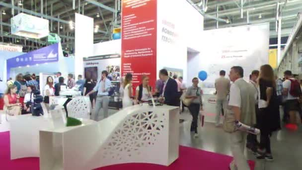 EKATERINBURG, RUSSIA - JULY 12TH, 2016: Exhibition INNOPROM THE MAIN INDUSTRIAL TRADE FAIR. industrial design Stand. Video. UltraHD (4K)