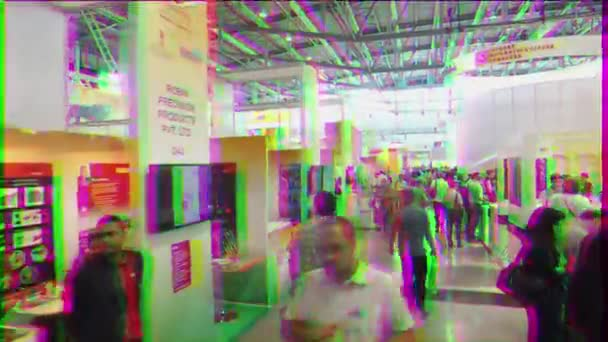 EKATERINBURG, RUSSIA - JULY 12TH, 2016: Exhibition INNOPROM THE MAIN INDUSTRIAL TRADE FAIR. Visitors view stands. Video. UltraHD (4K)