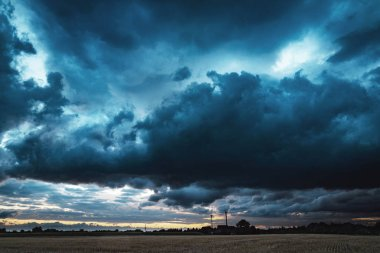 Strom clouds over farm field
