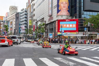 Shibuya, Tokyo, Japan - April 30, 2020: Mario kart on Shibuya district in Tokyo, Japan. Shibuya Crossing is one of the busiest crosswalks in the world.