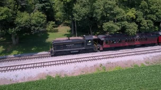 Lancaster, Pennsylvania, July 2019 - An Aerial View of a Diesel Locomotive Pulling Vintage Passenger Cars Through the Amish Countryside