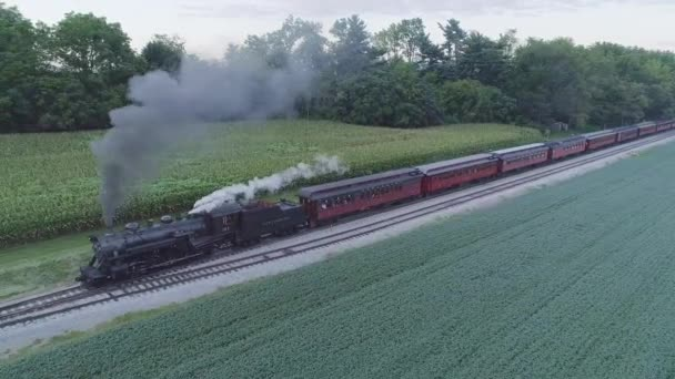 Strasburg, Pennsylvania, August 2019 - Aerial View on a Steam Passenger Train Waiting at a Station in the Amish Countryside on a Summer Day