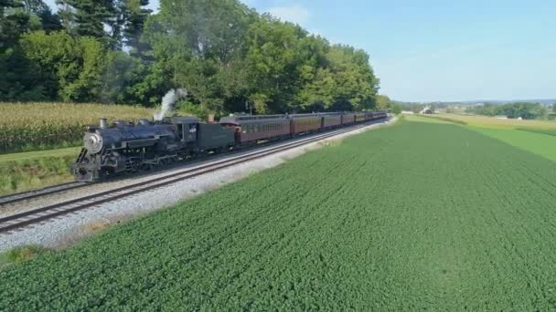Strasburg, Pennsylvania, August 2019 - Aerial View on an Approaching Steam Passenger Train in the Amish Countryside on a Summer Day