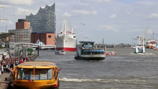Ferry boat with passengers sails on the Elbe river in Hamburg, Germany on October 2, 2019