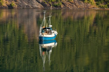 Small beautiful boat in a lake or in a large river