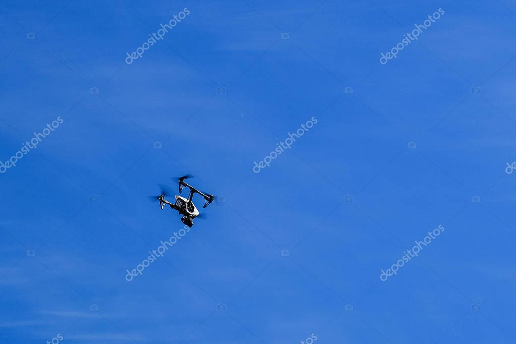 Aircraft quadcopter, drone with high quality video camera. Standing on earth.