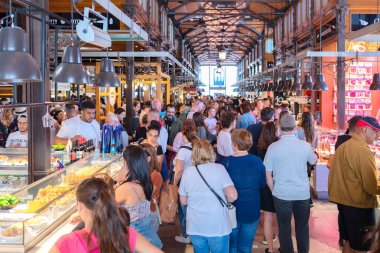 Madrid, Spain - May 10, 2019 - San Miguel Market located in Plaza de San Miguel  in center of Los Asturias Madrid full with local people and tourist searching for best tapas and local fresh traditional food and seafood