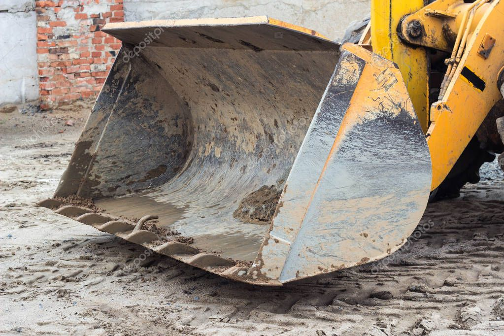 Large bucket of yellow tractor forklift, close-up, ladle