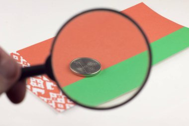 Belorussian money with magnifying glass, the Belarusian flag