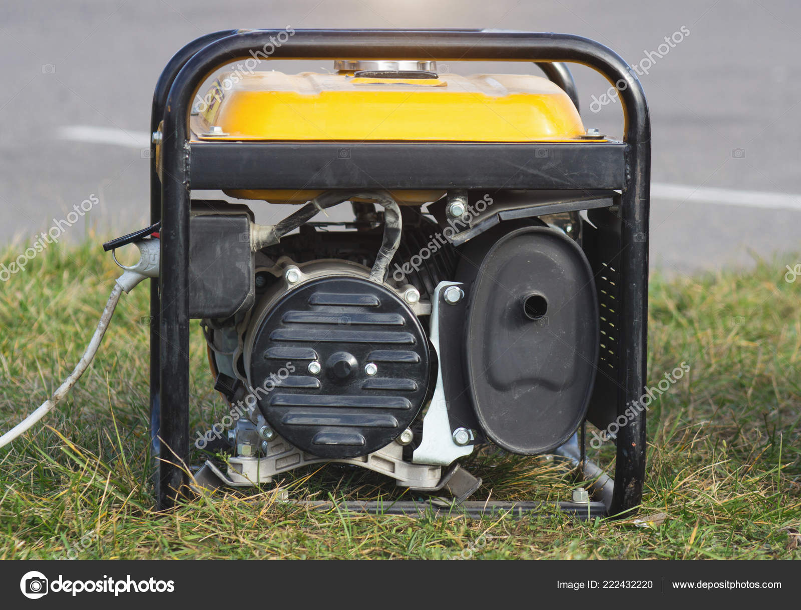 Portable gasoline generator, close-up, alternator