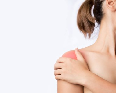 hand touching shoulder joint on white background, young woman holding shoulder joint and pain around deltoid muscle with space for text