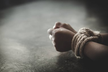 Hands tied up with rope of a missing kidnapped, abused, Violence