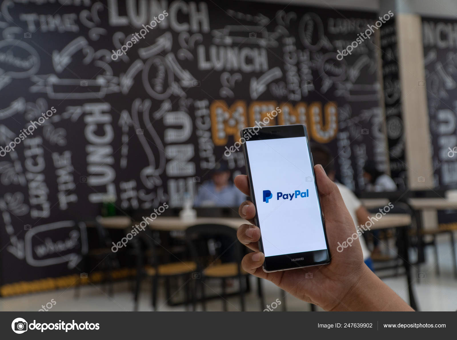 CHIANG MAI, THAILAND - JAN  06,2019: Man holding HUAWEI with