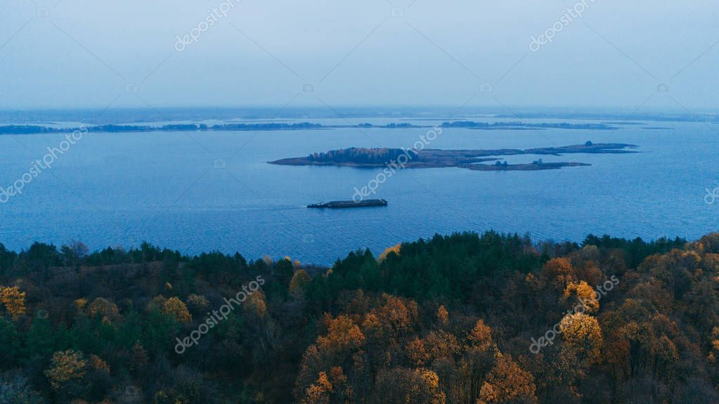 Aerial view of a barge in the Dnieper River. Autumn.