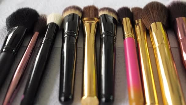 Close up set brushes lies on the table of a makeup artist in a beauty salon
