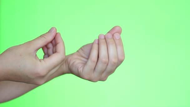Detail rukou gesto pro peníze. Chroma key pozadí. Zelená obrazovka. Izolovaný