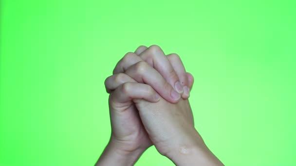 Ruce se modlí. Chroma key pozadí. Zelená obrazovka. Izolovaný