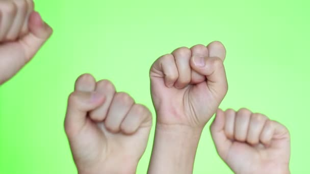 United people, labor movement, worker strike, election movement. Hands close-up. Protest illegal election concepts with males fist raised air fighting for their rights. Chroma key background
