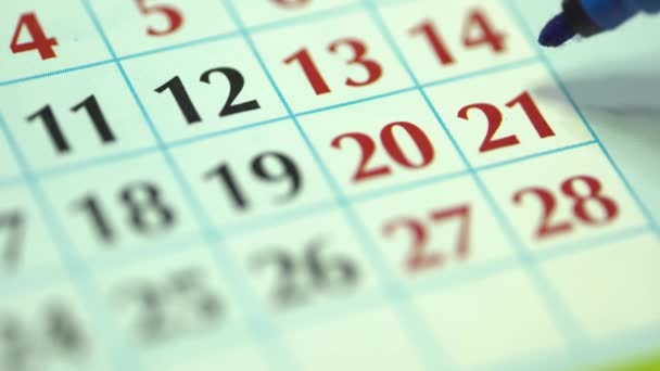 21st  twenty-first day of the month. The woman marks the calendar date with a blue marker. Business Wall Calendar Planner and Organizer