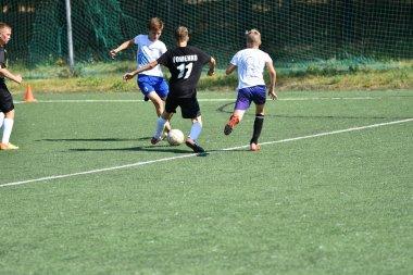 Orenburg, Russia - August 18, 2017 year: the boys play football on City tournament on mini-football