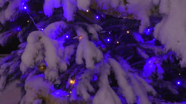 Garland with multicolored lights on the Christmas tree