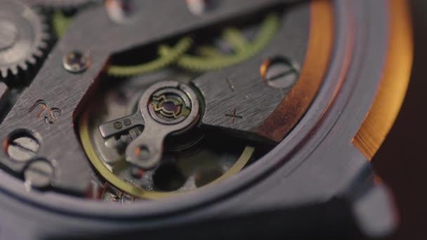 Macro shoot of working analog watch mechanism
