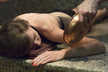 Young massagein hammam or turkish bath.