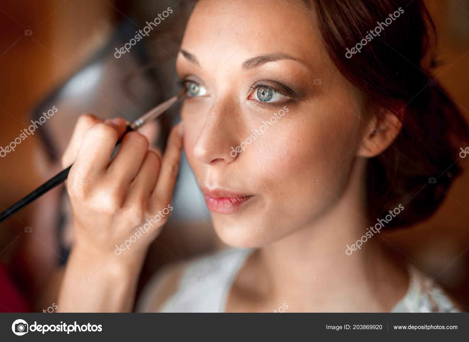 Process of making makeup  Make-up artist working with brush