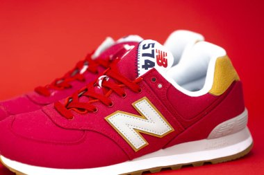 BOSTON, MA, USA, January 2019 - New Balance NB 574 athletic shoes on studio background. New Balance Athletics one of the worlds major sports footwear manufacturers. Illustrative editorial