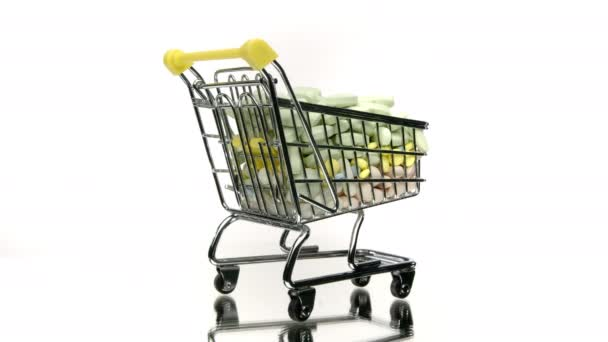 Close up shopping cart with medicines rotating isolated on white background