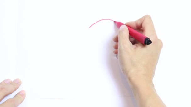 Womans hand drawing red heart with marker, shades and crosses out it on white table.