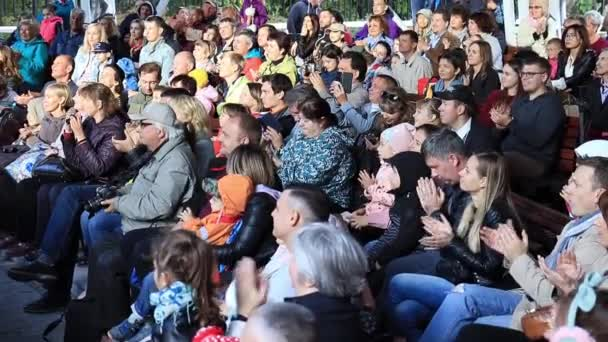 Moscow, Russia - October 01, 2019: An audience, crowd in a outdoor concert clapping, applauding the actors