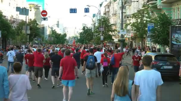 KYIV, UKRAINE, MAY 26: UEFA Champions League Final CUP 2018. FC Real Madrid and FC Liverpool. Fans in red T-shirts are walking along the street to the Olympic Stadium