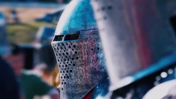 Knight Tournament. Knight before the fight. A man in iron armor with a number of standing knights ready for a duel