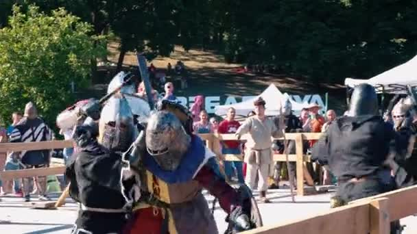 Ukraine, Kiev, June 9, 2018. Knight Tournament. Mass duel of knights in iron armor. The Knights are fighting