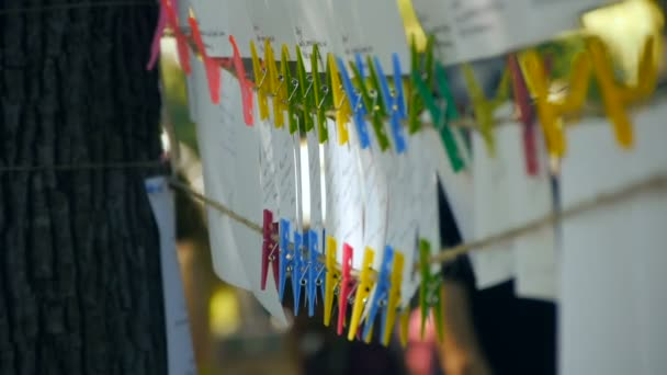 Photos on the rope attached with clothespins, photo drying
