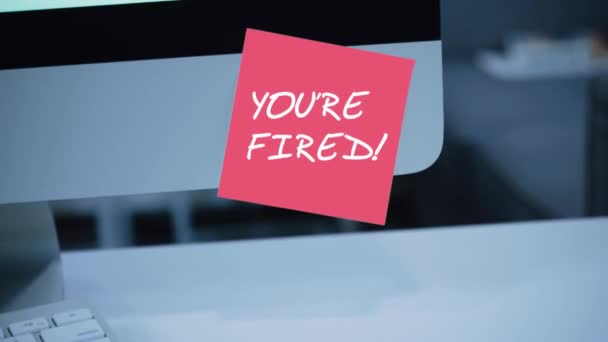 Youre fired. The inscription on the sticker on the monitor. Message. Motivation. Reminder. Handwritten text written with a marker. Color sticker. A message for an employee, a colleague