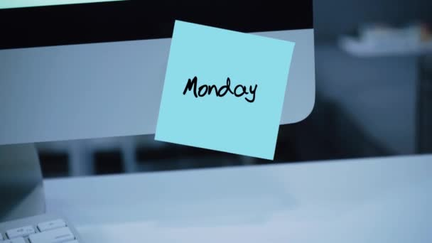 Monday. Days of the week. The inscription on the sticker on the monitor. Message. Motivation. Reminder. Handwritten text written with a marker. Color sticker. A message for an employee, a colleague