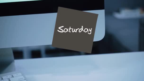 Saturday. Days of the week. The inscription on the sticker on the monitor. Message. Motivation. Reminder. Handwritten text written with a marker. Color sticker. A message for an employee, a colleague