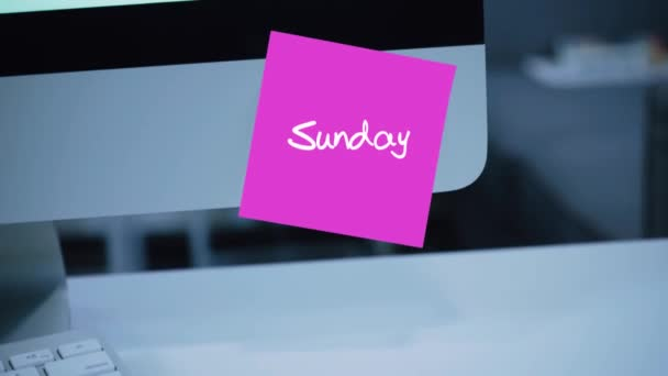 Sunday. Days of the week. The inscription on the sticker on the monitor. Message. Motivation. Reminder. Handwritten text written with a marker. Color sticker. A message for an employee, a colleague