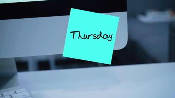 Thursday. Days of the week. The inscription on the sticker on the monitor. Message. Motivation. Reminder. Handwritten text written with a marker. Color sticker. A message for an employee, a colleague